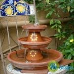 Edie created this fun fountain using clay pots and saucers