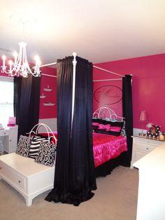 Bright pink walls, pillows, zebra print. Fun teen girls room
