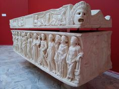 Roman marble sarcophagus showing the Muses and an apotropaic mask. From Isola Sacra, Ostia. 2nd C AD.