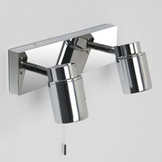 Como bathroom spotlight.  Polished chrome finish.  Uses 2x35w (max) GU10 lamp.  IP44 rated, suitable for bathroom zones 2 and 3.  Class II, double-insulated.  Includes integral pull-cord switch.