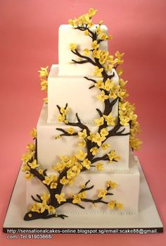 Gerogeous white base with yellow flowers Wedding cake from singapore.