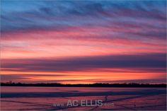 Sunset on a frozen Lake Campbell in South Dakota