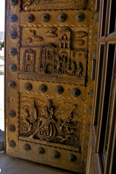 South America... Detail of the carved wooden door to the Basilica of Our Lady of Copacabana, Bolivia.