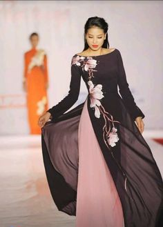 black and gold Vietnamese wedding dress (ao dai) Vietnamese traditional dress Pham Winter wedding dress inspiration. Vietnamese Traditional Dress, Vietnamese Dress, Traditional Dresses, Vietnamese Clothing, Modest Fashion, Hijab Fashion, Fashion Dresses, Maxi Dresses, Runway Fashion