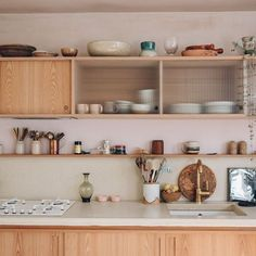 .This is exactly what I am aiming for - closed cabinets with glass shields to make the overall effect look light #kitchencabinets #kitchen #kitchendesignideas #kitchenorganization #kitchenstorage
