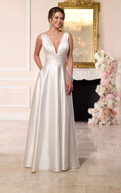 Fall in love with a rich Luxe Satin Wedding Dress from Stella York! Two vertically ruched straps, buttery soft silk and a figure-flattering waistband.