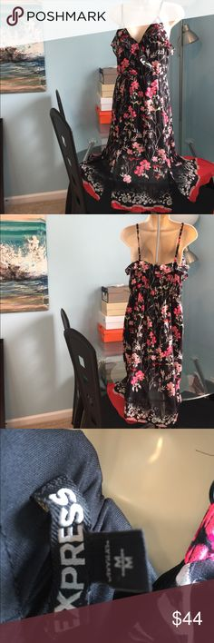 Express Clothing Brand Dress Side slit black with floral decor in pink, purple, red & cream. Red trim bottom. Almost mid calf length for someone 5'5 for example. New without tags. Never worn. True to size. Polyester outer layer, stretch under layer. Pet/Smoke Free Home. Bundle for discount. Offer away! Express Dresses Midi