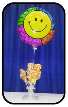 """Here is a possibility with our Air Bouquet with small base product - use to hold lollipops and an 18 inch foil in the center - #betallic #mightybright Mighty Smiley 21"""" Mighty Bright Balloon"""