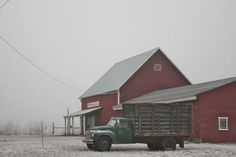 antique truck & red barn in heavy frost