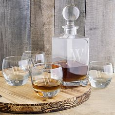 Classic elegance is artfully crafted into our Personalized Square Whiskey Decanter Set. Holding up to 32 ounces and sealed with a glass domed topper, this heavy-weighted decanter is accompanied by four heavy based whiskey glasses. Whiskey Decanter, Whiskey Glasses, Glass Beverage Dispenser, Whiskey Gifts, Scotch Whiskey, How To Make Oil, Hand Blown Glass, Clear Glass, Bar Ideas