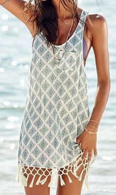 Beach cover up Love the colors and sleeveless is nice but I think at least short sleeve is necessary