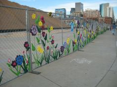 Looking for new ideas to inspire your knitting? Yarn bombing is a type of street art (think graffiti Fence Weaving, Chain Link Fence, Garden Fencing, Garden Art, Crochet Yarn, Knitting Yarn, Fence Art, Collaborative Art, Yarn Bombing