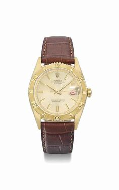 """Rolex. An 18K gold automatic wristwatch with sweep centre seconds, alternate red and black date, """"Thunderbird"""" bezel and champagne dial, circa 1958 #ChristiesWatches"""