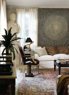 classic and beautiful...antique oriental rug, bold big artwork, bust, ....