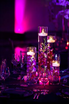 Purple dendro orchids submerged with floating candles- simple & stunning