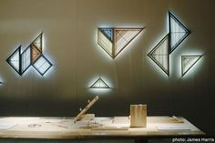 A series of lamps or artificial windows. Each individual slat is lined with LEDs that replicate the color temperature of daylight. The light emitted is reflected back from the wall to produce the impression that a real window lies behind. http://www.philippemalouin.com/welcome.html by Philippe Malouin