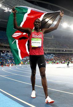 David Lekuta Rudisha of Kenya celebrates with the flag of Kenya after winning…