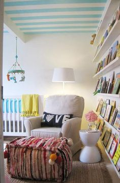 Elizabeth Sullivan Design Chic yellow & turquoise blue gender neutral nursery design with blue striped painted ceiling, white modern crib with turquoise blue crib bedding, yellow tassle throw blanket, turquoise blue & green Big Jungle mobile, tan glider Striped Ceiling, Striped Walls, White Walls, Inspiration Wand, Nursery Inspiration, White Accent Table, Blue Crib, Wall Bookshelves, Book Shelves