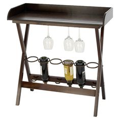 Keep your cellar favorites close at hand with this handmade wine table, perfect for sunroom gatherings and dinner parties.    Product: ...