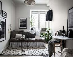 Use throw pillows to transform your bed into a comfortable couch when guests come over.