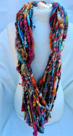 Hand spun thick and thin art yarn coils 'Mardi Gras' by woolhousecasalana on Etsy