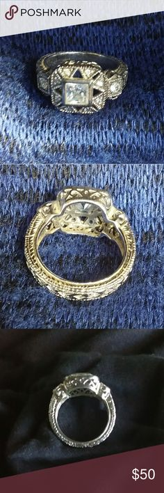 CZ Diamond Figaro .925 Sterling Silver Ring One of my most beautiful rings of all. It is 23 years old and looks as beautiful as the day I purchased it. Back then, the clear colored CZ's were not cheap. I purchased it for $95.00 and it is stamped .925 as you can see in the last picture. It fits so comfortable on your finger and sparkles in the sun or florescent lights. Jewelry Rings