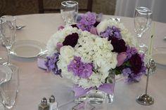 White Hall, white hydrangea, lavender phlox, lav stock, lavender tulips, white roses, dark purple carnations