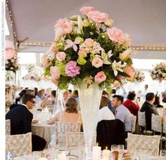 When it comes to floral design, Celebrations is always experimenting with innovative ways to display centerpieces. For her daughter's wedding, Jo-Anne and her team created extravagant spheres of lilies, roses, stephanotis, ranunculuses, and peonies resting on clear vases filled with crystallized gel for a champagne bubble effect.    Photo: Rebecca Davidson