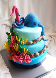 Octopus Reef Birthday cake - A 3 teired cake for a First birthday!   Flavours: Blue velvet with cream cheese frosting, Blue marble vanilla and (Blue) strawberries and cream :)