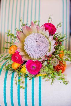 A king protea and ranunculus bridal bouquet   Brides.com