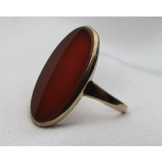 This is a striking vintage 9KT yellow gold ring centered by a beautiful flat oval sardonyx stone.