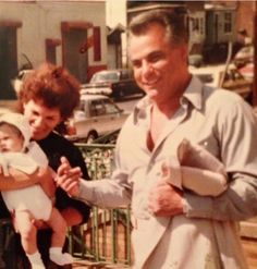 John Gotti with his first grandkid Frankie, at his baptism at Nativity Church, Ozone Park (1984).