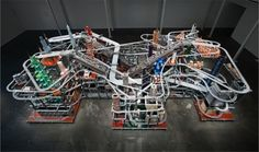 I saw a video of this and i have two impressions, first this is the hot wheels race track i wish i had and second it is appropriate that you can find this  on display at the LACMA. Very cool. Metropolis II by Chris Burden