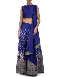 Ink blue sharara with gray and white thread embroidered floral and parrot motifs all over. This set includes matching blue sleeveless blouse with scoop neck and attached embroidered drape. Wash Care: Dry clean onlyClosure: Zip at side
