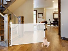 Retract-A-Gate - Retractable Safety Gate, Retractable Baby Gate, or Retractable Pet Gate. An easy to use wide safety gate for indoors or outdoors and certified for use at the top of stairs.