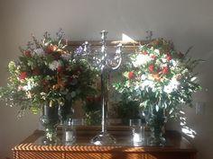 Elegant arrangements with large tropical leaves in vases www.racheljeansevents.com