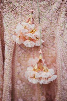Pretty blush pink lehenga with tassel latkans. See more on wedmegood.com  #wedmegood #indianwedding #indianbride #latkans #accessories #bridallehenga #lehenga #lehengacholi
