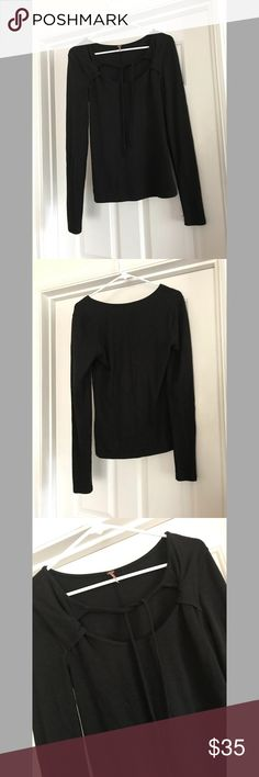 Free People long sleeve shirt Free People long sleeve shirt  Great condition  Tie in front at top Size Large  Cotton/Viscose/Spandex Free People Tops