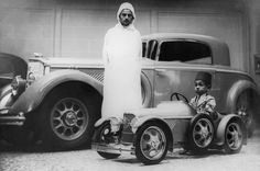 Prince Moulay Hassan, the future King Hassan II of Morocco, plays in the Casablanca in a replica of the French-made Panhard limousine, 1930