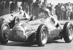 Silverstone GP, 1950 Fangio sitting on the grid in his Alfa Romeo 158. It was not a good race day.