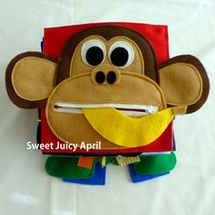 Monkey page. Monkey with zipper mouth and a felt banana inside for child to take out and put back in. The ears of the monkey extend beyond the