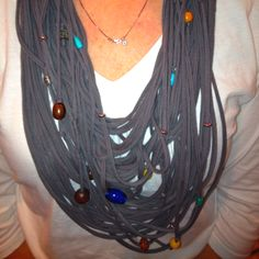 This is a scarf made of T-shirt strips cut from an XXL shirt...I cut 4 strips and added beads for bling, tying them to the strips at the neck...my first try and it was a success!