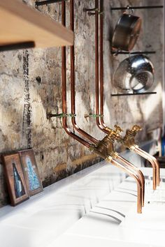 Exposed copper pipe taps in the kitchen. I think this image is from Grow Your Own Drugs film location. Is it really James Wong's home?