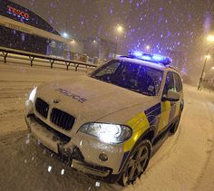 A Greater Manchester Police BMW motorway patrol vehicle battles through the snow across Salford Quays en route to the M602 motorway during the early hours of January 5th 2010. The day saw the biggest snowfall in central Manchester in 30 years, which created transport problems across the region.   Despite the extreme conditions, the Force met 97% of its response targets during the period. www.gmp.police.uk