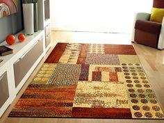 Alfombra de Lana Bali 786 Sualsa, con un elegante diseño de estilo patchwork a base de motivos geométricos.