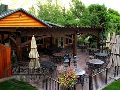 Free standing pergola with Rich Cordoba stain and Roosevelt Step profile. Upgraded arched knee braces.