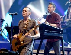 Mike Shinoda Photos Photos - Singer Chester Bennington (L) and singer/guitarist Mike Shinoda of Linkin Park perform onstage during the 2012 iHeartRadio Music Festival at the MGM Grand Garden Arena on September 22, 2012 in Las Vegas, Nevada. - 2012 iHeartRadio Music Festival - Day 2 - Show