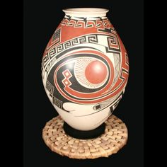 """White Clay Vase by: Miguel E Quezada, $289  mississippy clayworks, 10""""h 7.5""""w"""