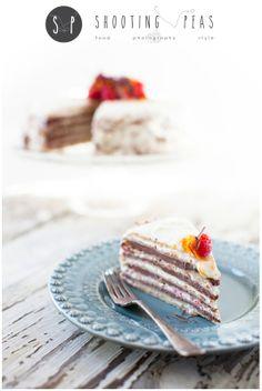 Raspberry & Chocolate Pancake Cake with Vanilla Frosting.  Happy Pancake Day!  www.shootingpeas.com