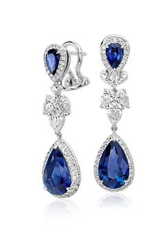 Vibrant color is captured in these exquisite earrings, showcasing 5.29 carats of blue sapphires highlighted by a dazzling halo of diamonds.